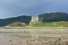 Castle Tioram and the beach at Dorlin at low tide in Autumn