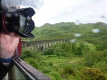 Taking photos and video on The Jacobite crossing The Glenfinnan Viaduct